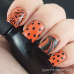 #npclairestelle8 Day 12: Orange and black manicure